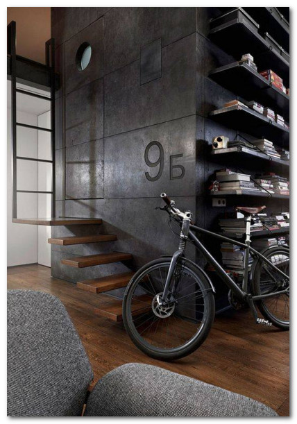 desain unik rak buku serta tangga bergaya gothic modern