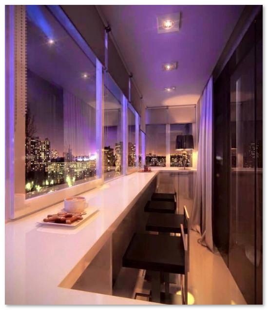 desain teras mini apartemen modern malam hari