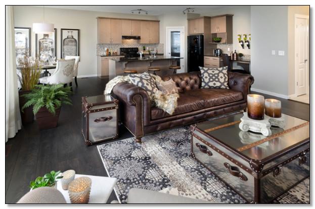 desain ruang tamu warna coklat dan abu dengan menambah elemen tanaman hidup agar ruangan tetap segar
