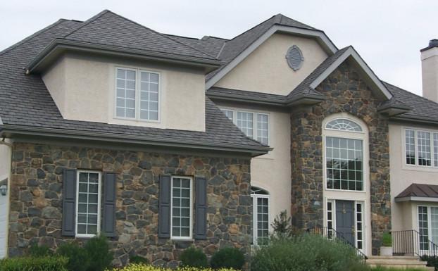model rumah minimalis tampak depan dengan elemen batu alam