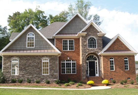 rumah minimalis puncak dengan batu alam tampak depan