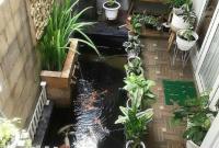 Kolam-Ikan-Mungil-di-Taman-Kecil-Rumah-Minimalis