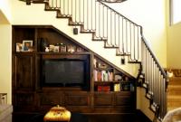 ruang bawah tangga untuk rak tv pada ruang tamu